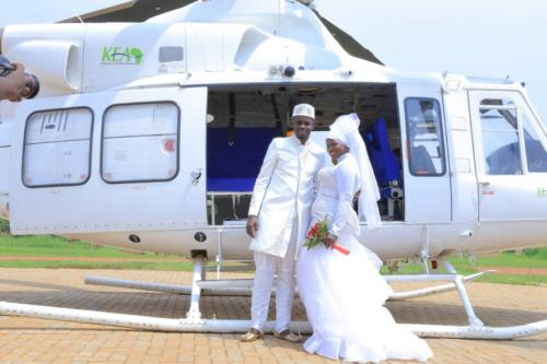 Couple board Helicopter